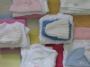 Bundles of knitted clothes ready for the babies who are born with nothing